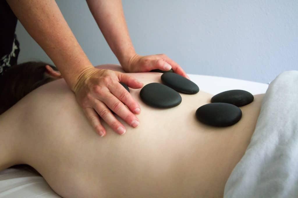 LutZen Reflections Massage Studio Hot Stone Back Massage