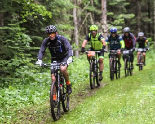 Lutsen 99er Bikers Cutting Through the Mud