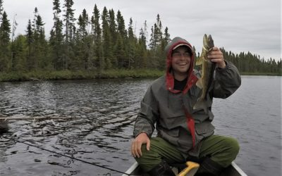 Boundary Waters Podcast host Joe Friedrichs catches a fish in the Boundary Waters Canoe Area Wilderness