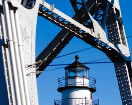 Lift Bridge with Lighthouse in the Background